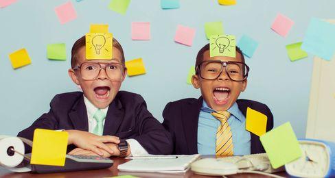 two kids having fun in business
