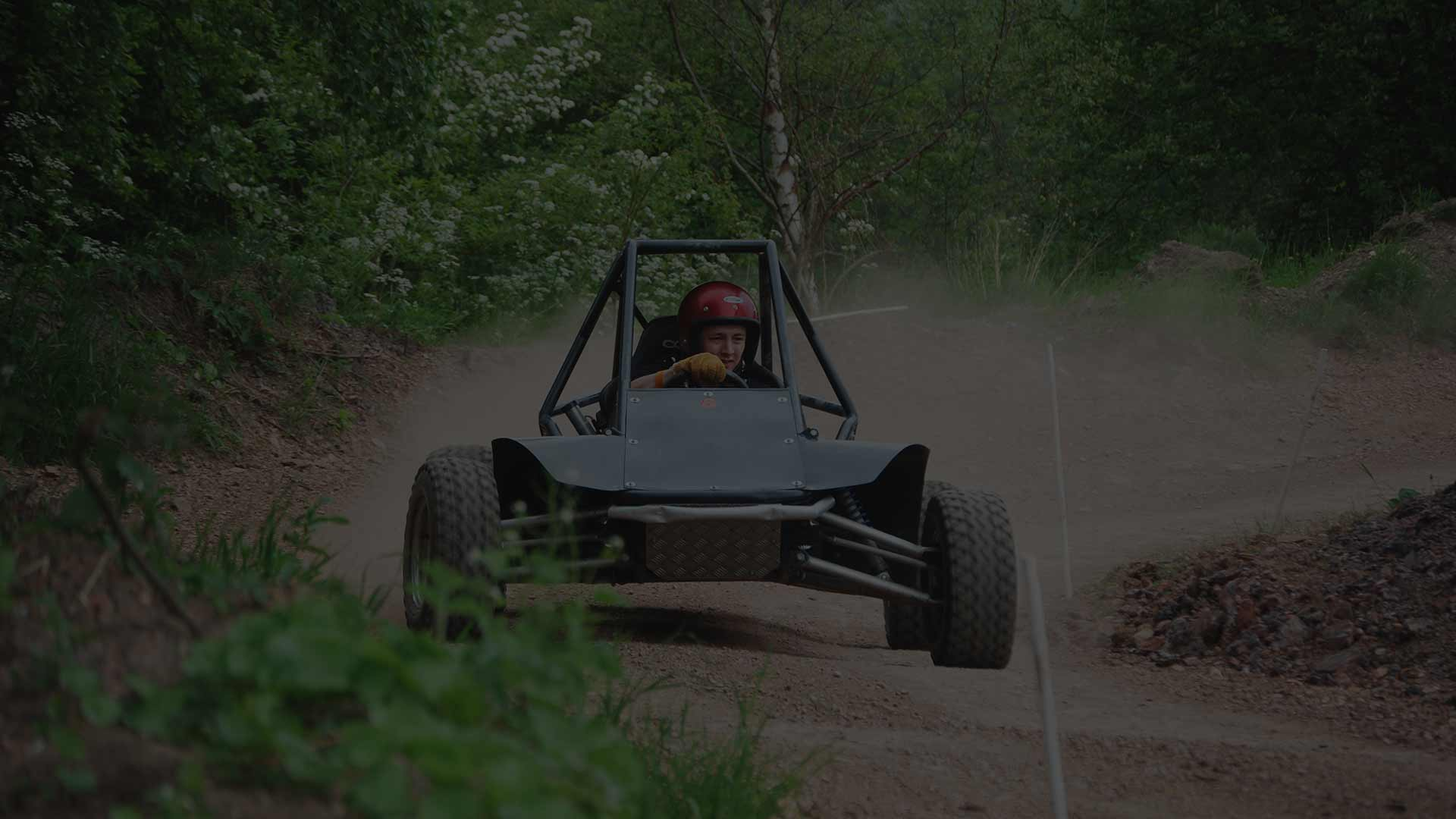 guy in a dirt buggy going round a corner